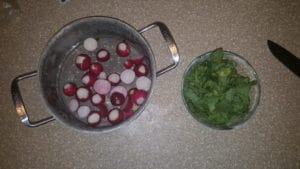 Cut the radishes and greens